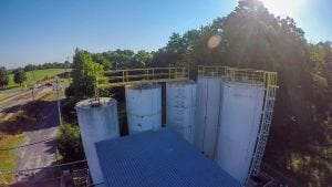Water tanks covered in dirt and grime